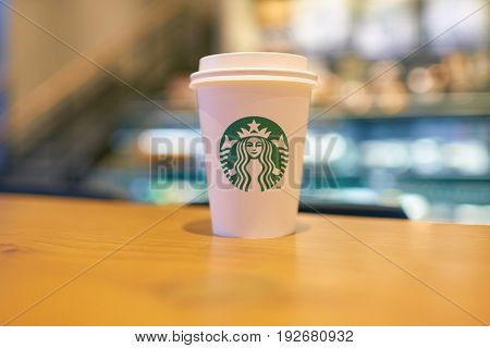 SEOUL, SOUTH KOREA - CIRCA JUNE, 2017: close up shot of Starbucks coffee take away cup. Starbucks Corporation is an American coffee company and coffeehouse chain.