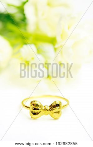 Gold Pendant Cameo Fancy Ring Jewelry In Bow Shape With Flowers Isolated On White