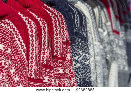 Norwegian sweaters with Knitted Scandinavian beautiful ornament.