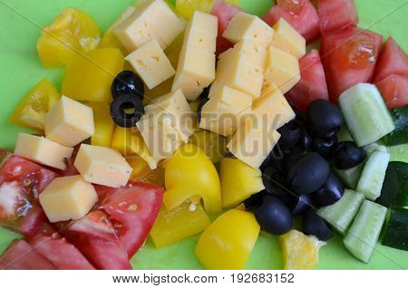 Ingredients for salad - pepper, tomato, cucumber, cheese,  olive