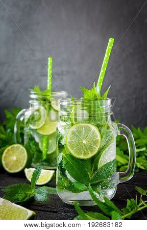 Mojito Cocktail With Lime And Mint In Highball Glass On A Black Stone Background Copy Space