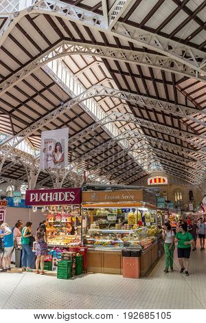 VALENCIA, SPAIN - JUNE 12, 2017: People shopping for food in the Mercado Central of Valencia, Spain