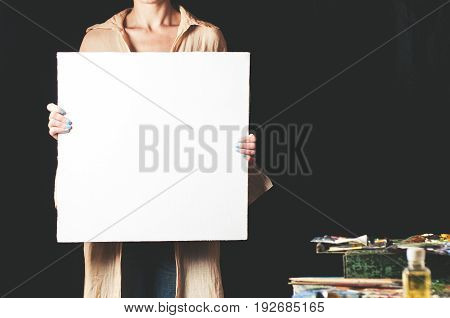 White Canvas In The Woman's Hands. The Place For The Text Or Design On A Canvas
