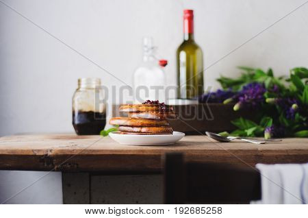 Bread And Jam On An Old Wooden Table. A Still Life With Lupines And Ware