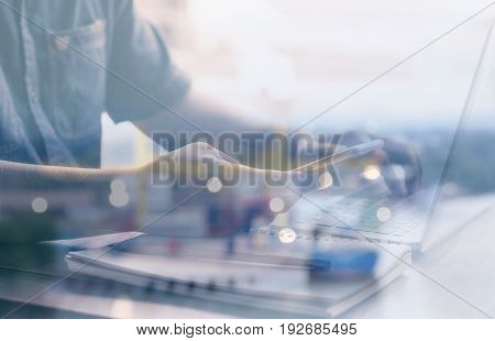 Close up Cell phone in hand businessman on background computer blurred Concepts & Ideas Style Double exposure backdrop