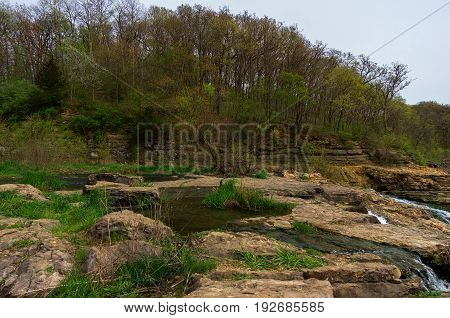 Rocky waterfall landscape.  Natural spillway between two lakes