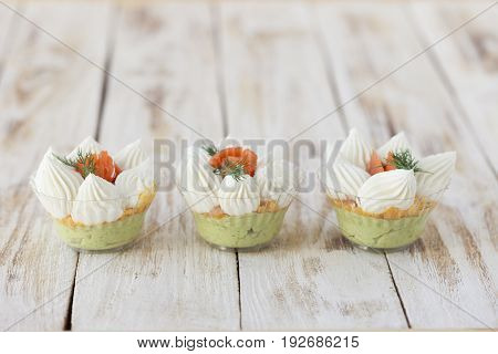Salmon salted trifle snack with avocado cream and cream fresh