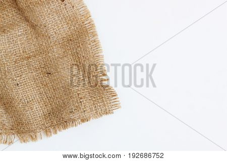 A piece of old burlap isolated on a white background.