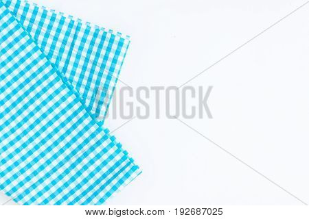 Turquoise blue cloth kitchen towel with checkered pattern isolated on white background isolated.
