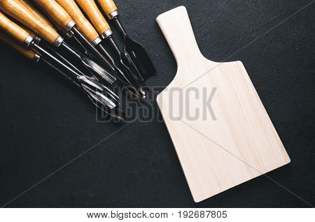 A Set Of Chisels On A Black Background