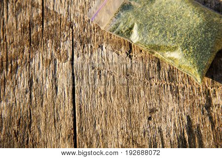 Marijuana In Packet On Wooden Background