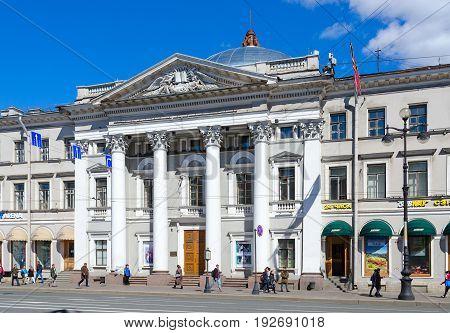 SAINT PETERSBURG RUSSIA - MAY 3 2017: Unknown people walk along Nevsky Prospekt near House of Dutch Reformed Church St. Petersburg Russia