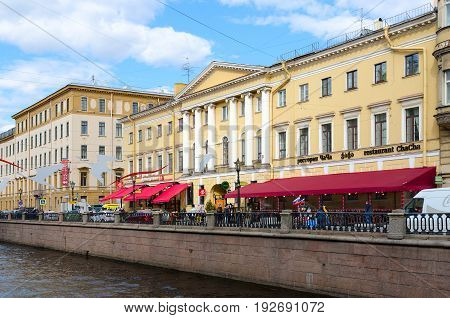SAINT PETERSBURG RUSSIA - MAY 3 2017: Unknown people walk along embankment of Griboyedov Canal St. Petersburg Russia