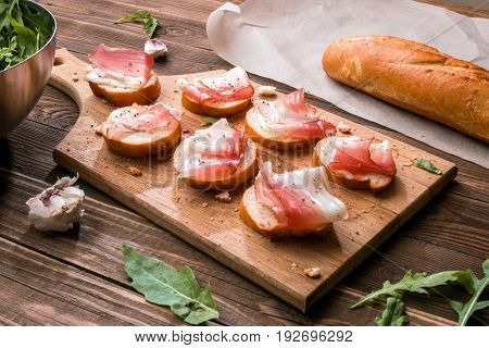 Wooden cutting board with sandwiches
