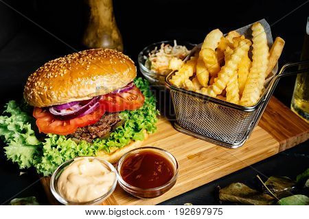 Tasty, Delicious, Beef Burger With Fresh Vegetables, Fries And Coleslaw