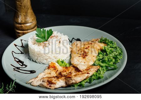 Grilled Chicken Breast With Risotto And Parsley Served At Bistro