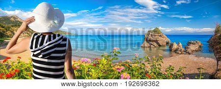 Woman Holding A Hat Against Porto Zorro Beach On Zakynthos Island, Greece