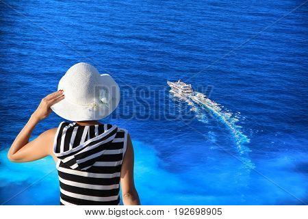 Woman Watching Tourist Boat On Zakynthos Island In Greece
