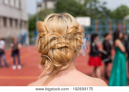 Modern haistyle hairdo of a girl at prom graduation