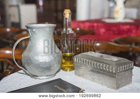 church utensil at the table glans the Bible on the table ceremony of water baptism various objects needed for baptism at Burgas