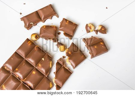 Broken Chocolate Bar With Nuts Isolated On White