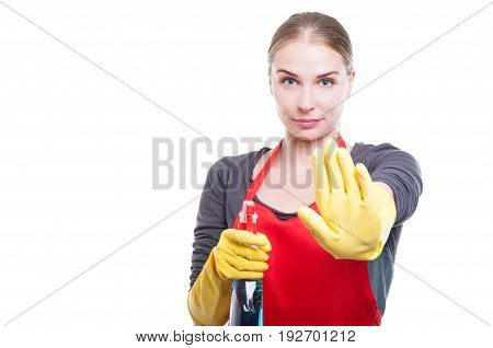 Pretty Young Housekeeper Doing Stop Gesture