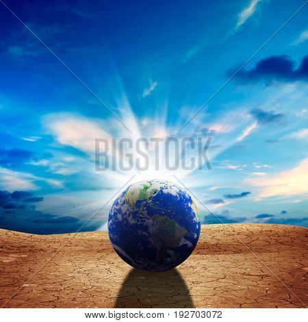 conceptual image of world dried landscape. NASA world map image layered and used;