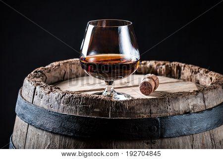 Glass Of Good Whisky On Oak Barrel