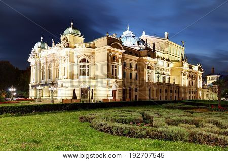 Juliusz Slowacki Theatre by night in Krakow Poland Eclectic style 19th century architecture.