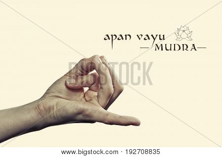 Apan vayu mudra. Yogic hand gesture. Isolated on toned background.