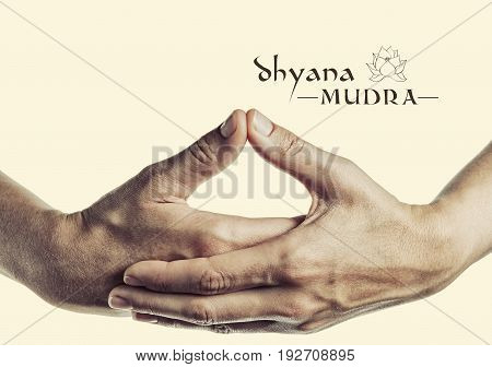 Dhyana mudra. Yogic hand gesture. Isolated on toned background.