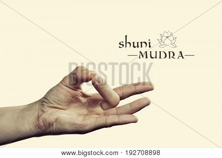Shuni mudra. Yogic hand gesture. Isolated on toned background.