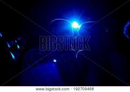 Silhouettes of a man and woman kissing at the cinema love happiness romance dating couple relationships lifestyle leisure entertaining concept.
