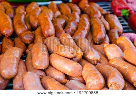 Group of raw sausage prepared for barbecue