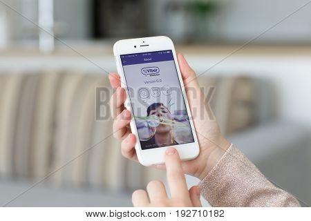 Alushta Russia - May 27 2017: Woman holding iPhone with client messaging and voice service Viber on the screen. iPhone was created and developed by the Apple inc.