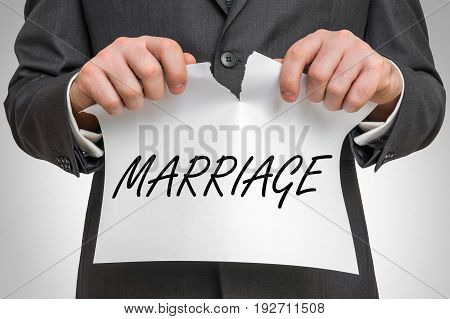 Businessman Tearing Paper With Marriage Word