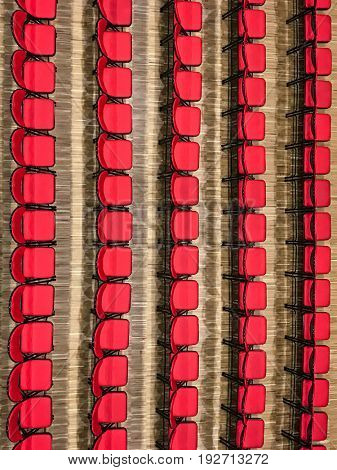 Rows of red chairs in a concert hall