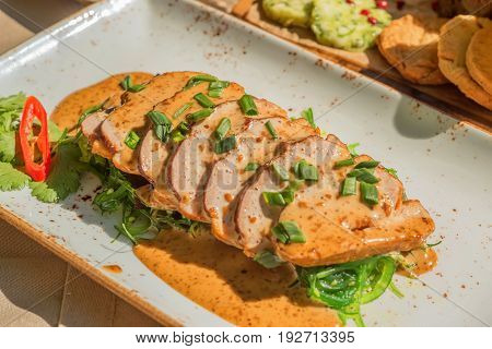 Slices of delicious goose liver paste with onion and herbs