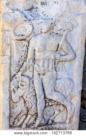 Close up antique bas relief carving of Hermes