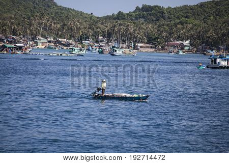 PHU QUOC, VIETNAM - March 21, 2017: Lifestyle of fishermen on their boats in An Thoi pier village, Phu Quoc island, Vietnam
