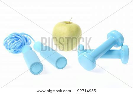 Healthy Lifestyle Composition: Fresh Green Apple With Cyan Blue Dumbbells