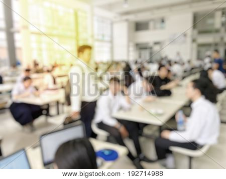 Blurred Image Of Canteen Or  Cafeteria Interior, A Lot Of People Are Eating Food In University Cante
