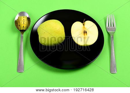 Dish For Vegetarian Lunch Holding Half And Whole Green Apple