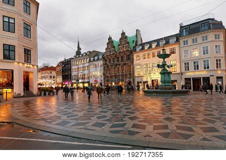 COPENHAGEN, DENMARK - NOVEMBER 6, 2016: People walking at the Stork Fountain on Amagertorv square. The fountain erected in 1894 by design of  Edvard Petersen and Vilhelm Bissen
