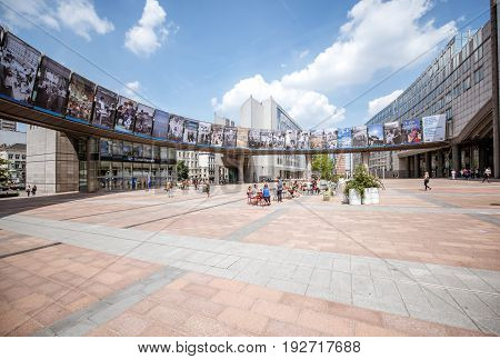 BRUSSELS, BELGIUM - June 01, 2017: Square with people near the European Parliament building in Brussels