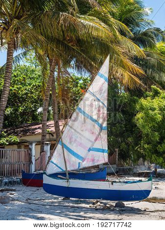 Ramena Madagascar - December 20 2015: Traditional Malagasy wooden fishing sail boats on the sea coast Madagascar. Ramena is a charming steadily growing fishing village located in Diego Suarez Bay.