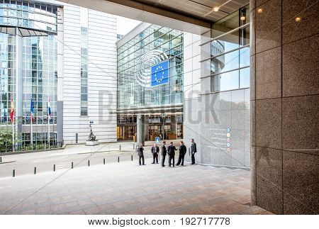 BRUSSELS, BELGIUM - June 01, 2017: Group of business people or deputies standing near the European parliament building in Brussels