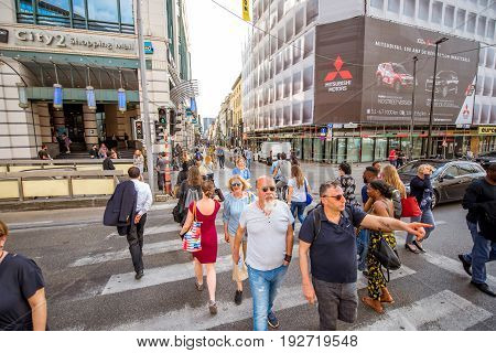 BRUSSELS, BELGIUM - June 01, 2017: People walk on the famous Neuve shopping street in Brussels