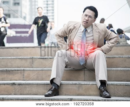 businessman suffer from stomachache, concept with Healthcare And Medicine.
