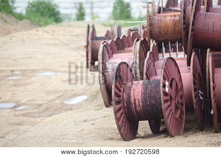 few giant roll of telecommunication cable on ground